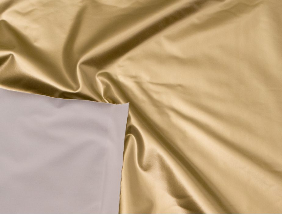 White Backing Shown On Top Of Metallic Gold Pvc Fabric